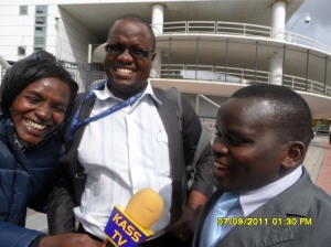 African Press International photo: Mr Joshua Sang in a happy mood, with Kass reporter Jessang and one of his lawyers Mr Bosek