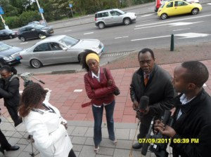 African Press International photo: Kass journalist with Camera, Jeptoo (left on photo and TV K24 reporter Jeff Koinange together with Kenyans attending confirmation of charges hearings at the Hague, On the steps of the ICC waiting for Hon Ruto, Hon Kosgey and Mr Sang to come out after the proceedings adjourned for the day