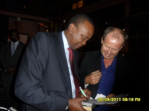 African Press International photo: Hon Kenyatta with one of the people who are at the Hague to give the suspects moral support