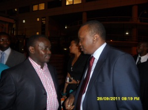 African Press International photo: Hon Kenyatta with Hon Joseph Gitari, Kirinyag Central MP at the Hague to give the suspects moral support