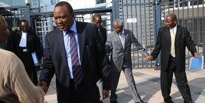 African Press International: Hon Uhuru Kenyatta handshaking with Mr Sammy Korir at the ICC stairs in the Hague - also on the photo is Counsel for General Hussein Ali Mr Kennedy Ogeto (between Korir and Uhuru). Mr Francis Muthaura's son partly hidden behind Hon. Uhuru, Mr Francis Muthaura and on the right - a security officer holding Muthaura's hand