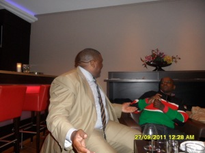 www.africanpress.me: Uganda's David Nyekorach Matsanga discus a point with Dennis Itumbi at the Hotel in the Hague during the ICC Kenya case in September 2011