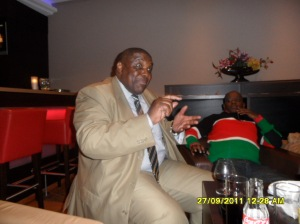 www.africanpress.me: Uganda's David Nyekorach Matsanga discus a point with Dennis Itumbi at the Hotel in the Hague during the ICC Kenya case in September 2011 - 2