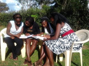 www.africanpress.me/ Grace going through notes on HIV-AIDS with Girls at Masinde Muliro University