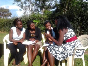 www.africanpress.me/ Grace (right) explains to Girls on the importance of protecting oneself from the deadly disease Hiv-Aids