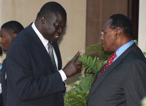www.africanpress.me/ Prof. Saitoti (left) and his fierce and finger-pointing Assistant Ojode (right)