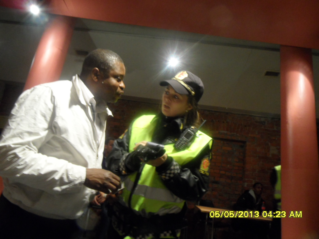 www.africanpress.me/ Gabriel makes a point to the policewoman who came to the venue to cool the situation