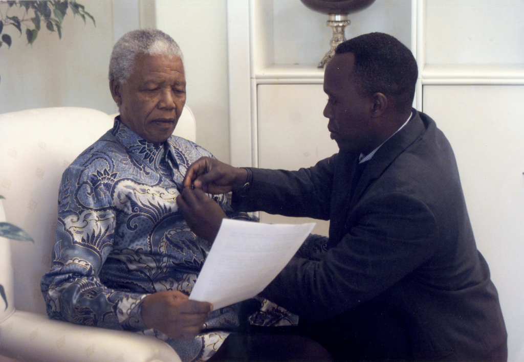 JK. Adjusting the microphone for one of many interviews with Madiba at his home in Houghton, Johannesburg, 2000 copy