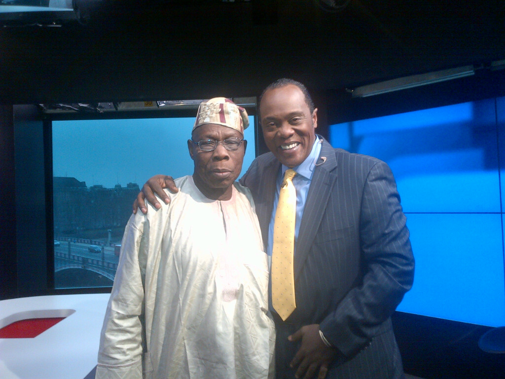 JK. Posing with Former Nigerian  President, Olusegun Obasanjo, after an interview at our ARISE Studios in London, 2013