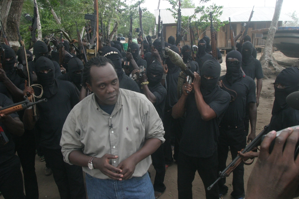 JK Surrounded by MEND Rebels as I record my 'Piece to Camera', Niger Delta, 2006